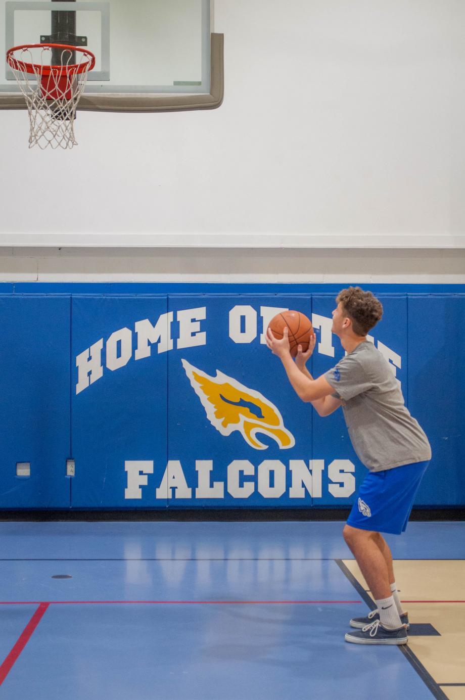 Faith Christian Academy basketball player prepares to make a shot.
