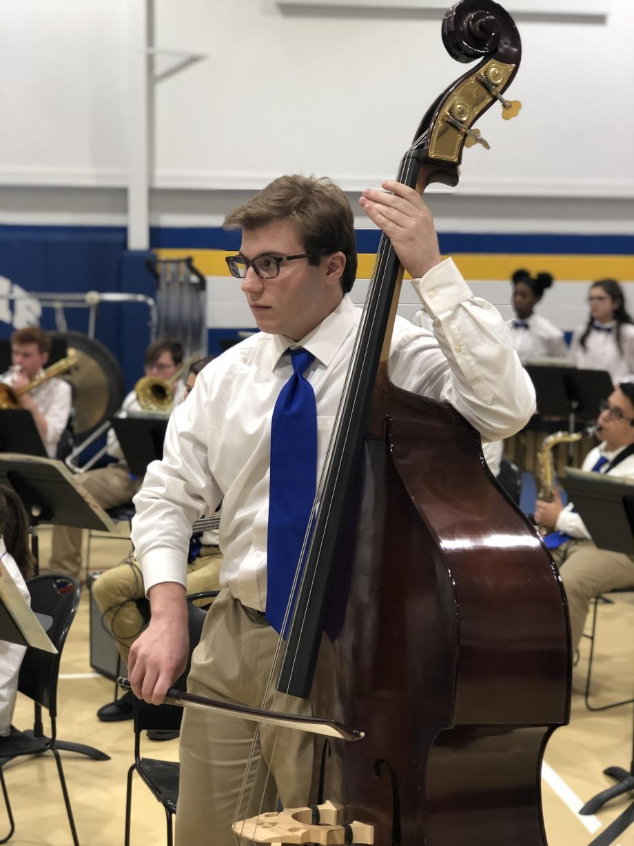 Student playing bass
