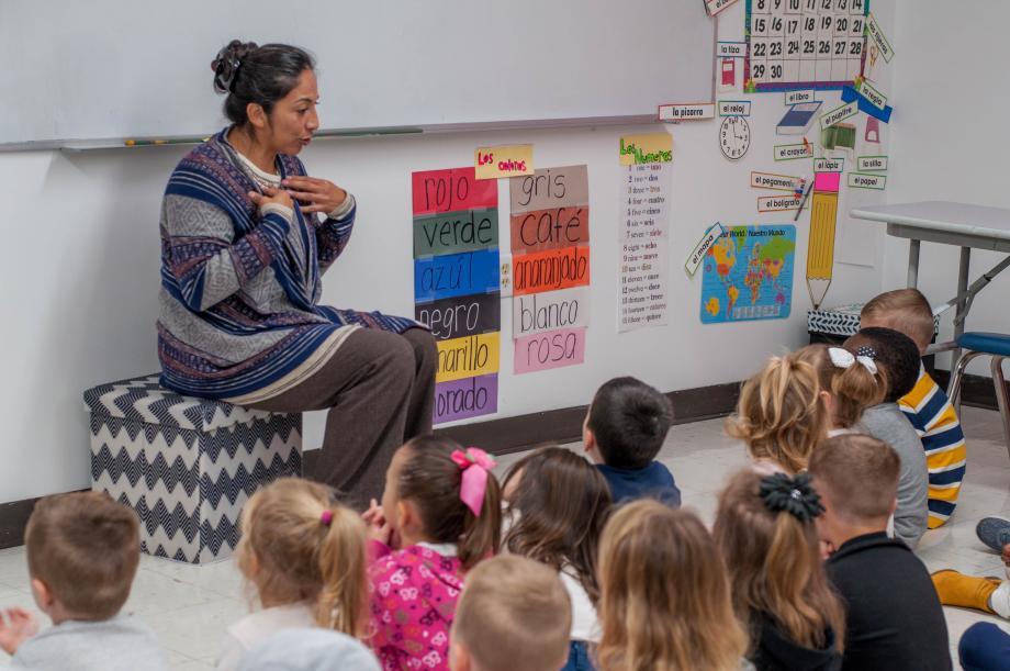 Teacher Speaking to Students during a Spanish Lesson